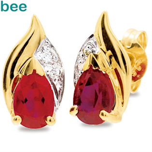 9 carat diamond stud with ruby